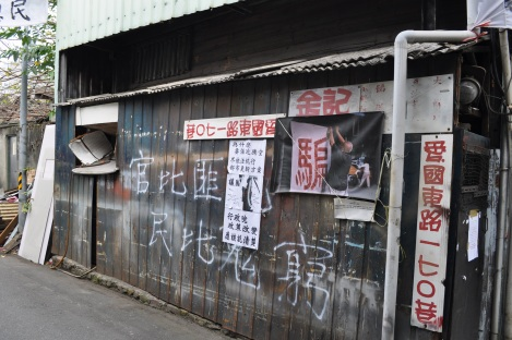 a resident uses graffiti in protest/huaguang community, taipei/feb 3, 2013